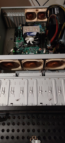 Motherboard, PSU, and Fans installed in the case. Pre-Cable management..